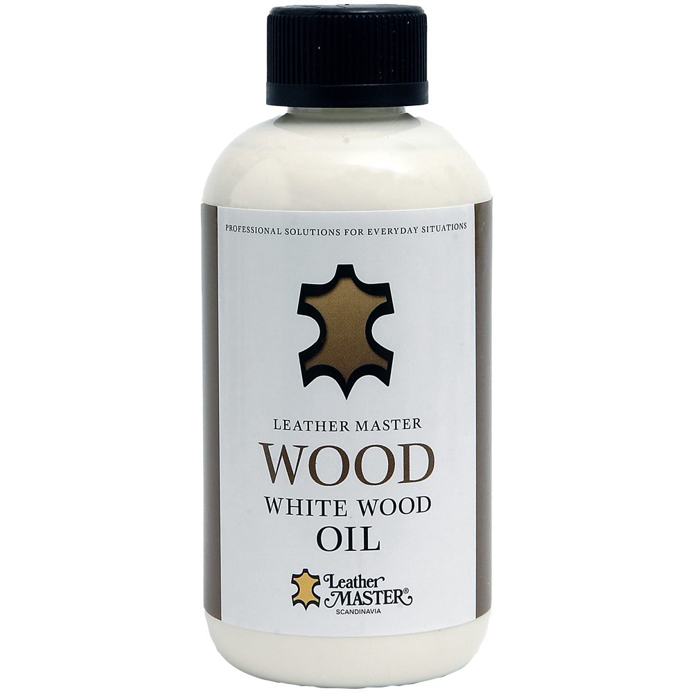 Genomskinlig flaska med svart kork med White Wood Oil