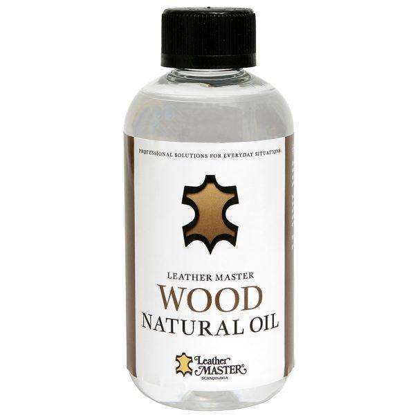 Vit genomskinlig flaska innehållande genomskinlig natural träolja