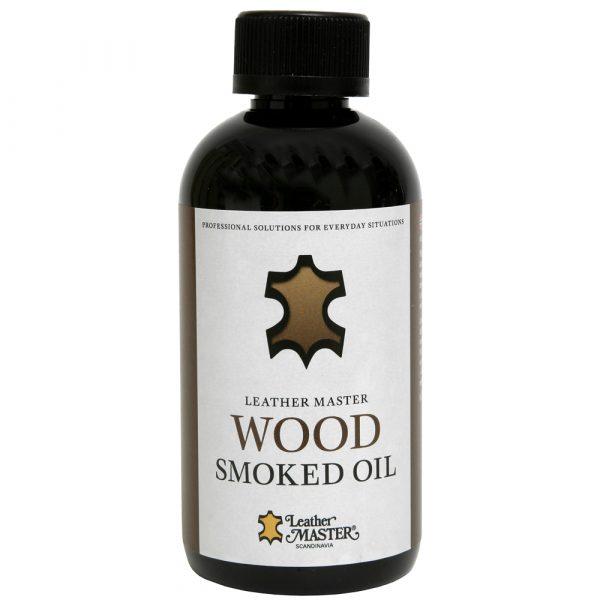 Mörk flaska med svart kork innehållande smoked träolja