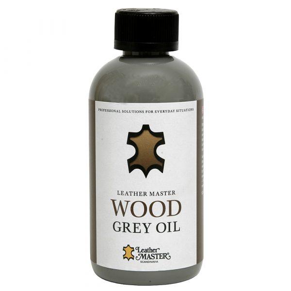 Grå flaska med svart kork innehållande grå träolja